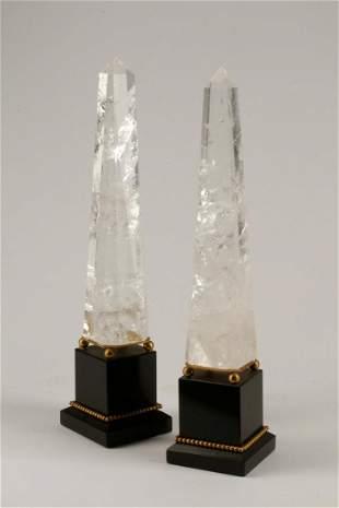 Pair of gilt metal, rock crystal & slate obelisks