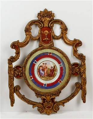 A Continental porcelain plate in giltwood surround