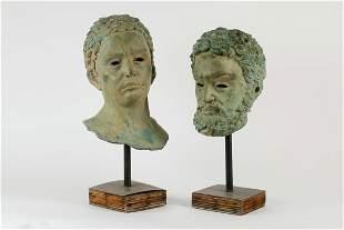 Two verdigris bronze heads