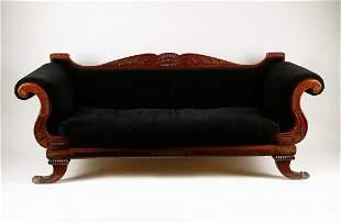 A William IV cut brass inlaid mahogany settee