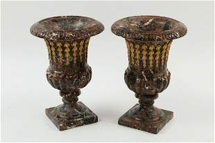 A pair of Neoclassical style marble urns