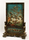 A Chinese  lacquered & relief decorated screen