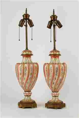 A pair of French porcelain urns, as lamps