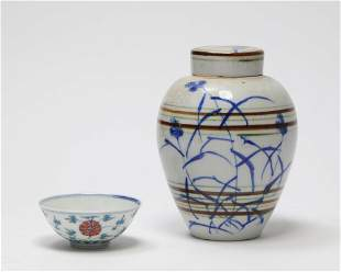 A Chinese porcelain covered jar and tea bowl