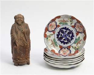 Six Imari porcelain dishes and a carved figure