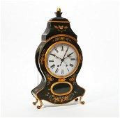 A Continental Rococo quarter chiming bracket clock