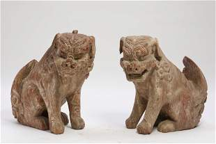 A pair of Japanese carved wood guardian lions