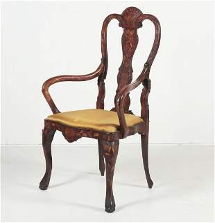 A Dutch Rococo walnut and marquetry armchair