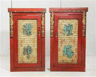 A pair of Chinese red painted side cupboards