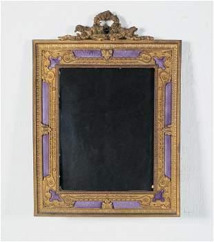 A French gilt bronze enamel easel back frame
