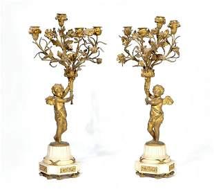 Pair of Louis XVI style bronze candelabra