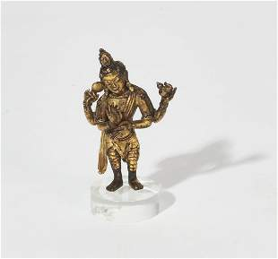 Southeast Asian gilt bronze four arm deity