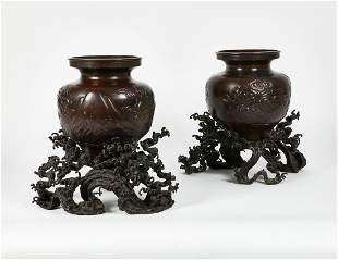 A pair of Japanese patinated bronze vases