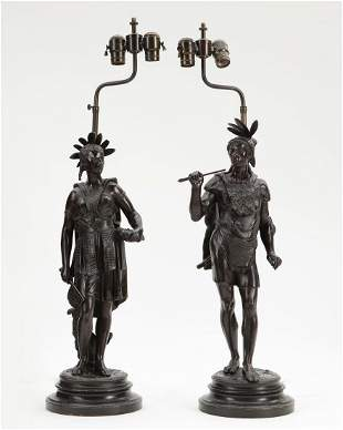 A pair of French patinated metal figures
