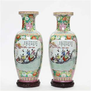 A pair of Chinese polychrome porcelain vases
