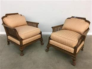 A pair of George III style caned armchairs