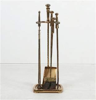 A set of Brutalist hammered gilt metal fire tools