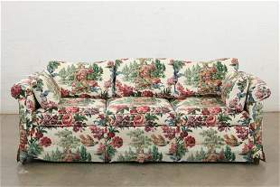 A Baker fully upholstered chesterfield style sofa