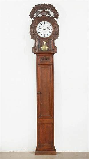 A French provincial carved oak tall case clock