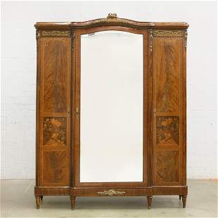 French gilt bronze mounted mahogany armoire