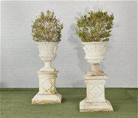Pair of painted stone campana urns