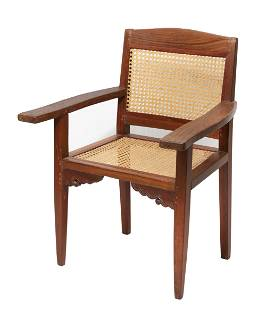 An Anglo Indian teak and cane paneled armchair