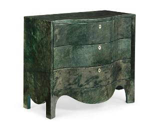 A faux shagreen serpentine chest of drawers