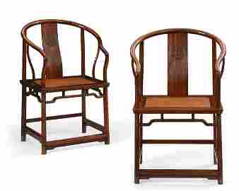 Pair of Chinese hardwood horseshoe back armchairs