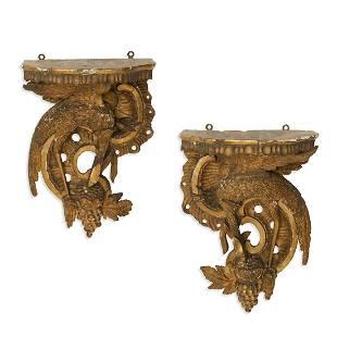 A pair of Italian Rococo stork form wall brackets