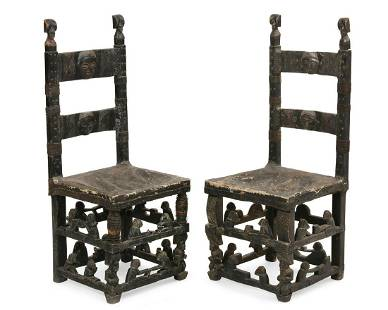A pair of African ebonized side chairs