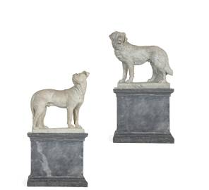 A near pair of life size Italian marble models of dogs