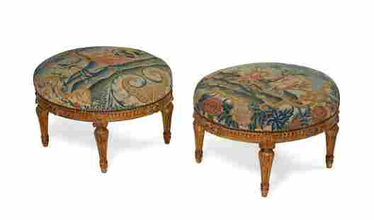 A pair of Louis XVI style giltwood stools