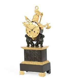 A Charles X bronze military trophy mantel clock