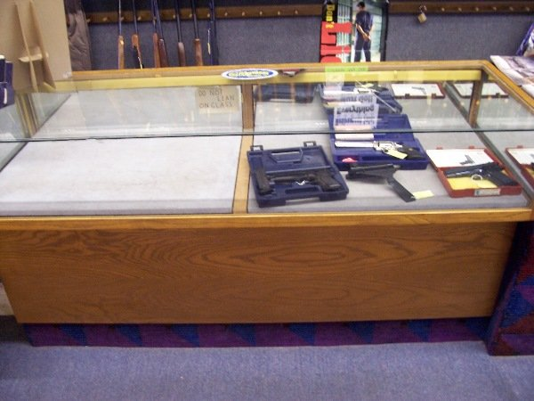 "1106: glass case with slide out drawers 26""x72"""