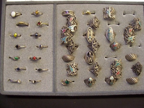 413: assorted native rings, silver and turquoise q. 38