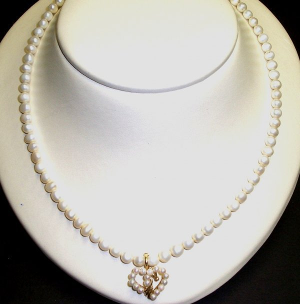304: 14K YELLOW GOLD CULTURED PEARL NECKLACE AND ENHANC
