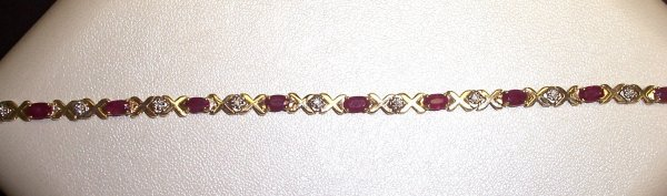 311: 14K RUBY AND DIAMOND BRACELET
