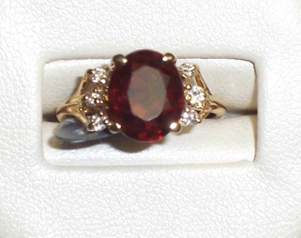 320: 14K GARNET & DIAMOND RING