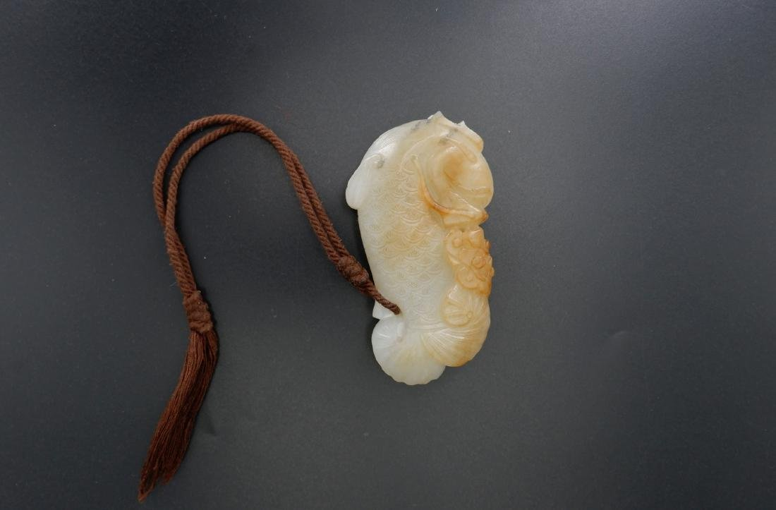A CARVED JADE' FISH' PENDANT, QING DYNASTY