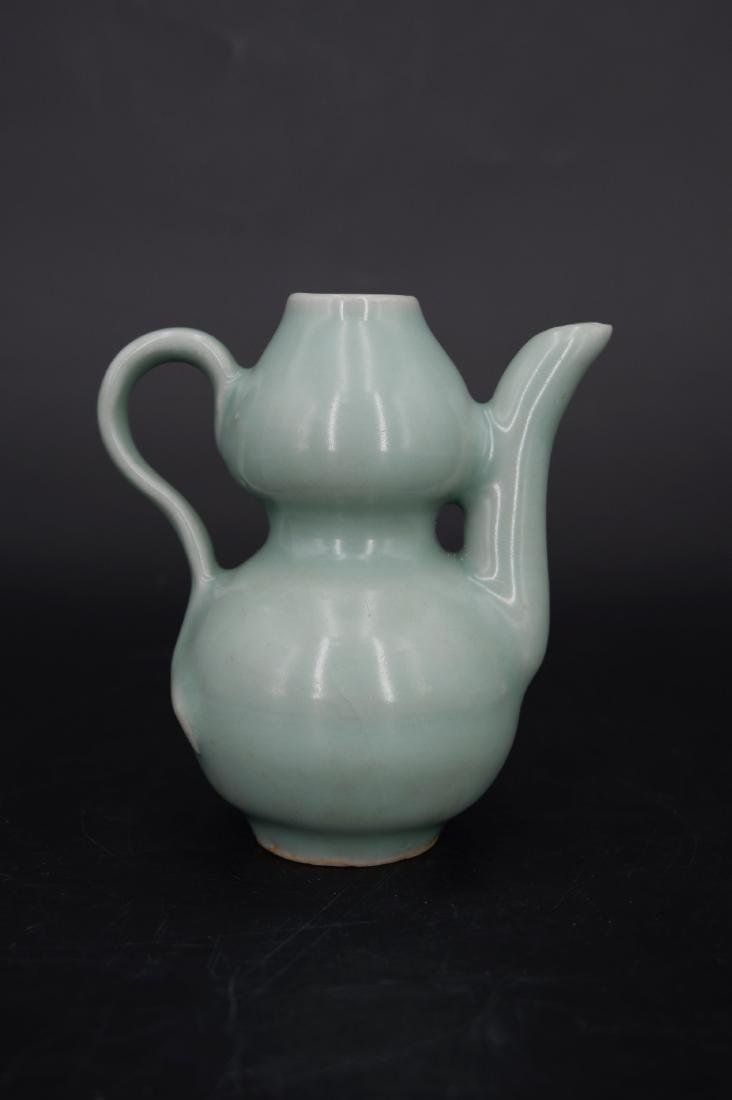 A CHINESE LONGQUAN CELADON WATER DROPPER, SONG DYNASTY