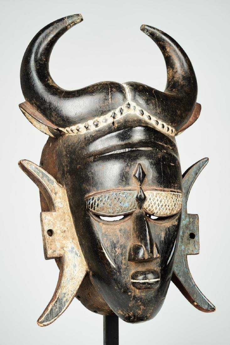 A Jimini mask with large buffalo horns Tribal Art