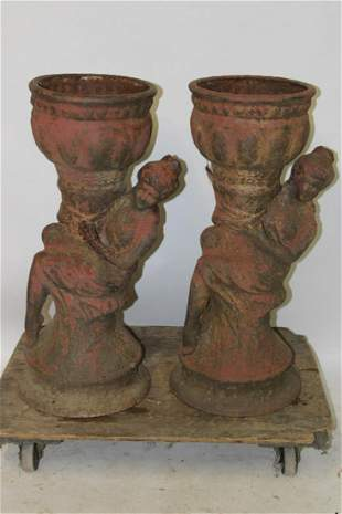 Match Pair of Cast Iron Figural Urns