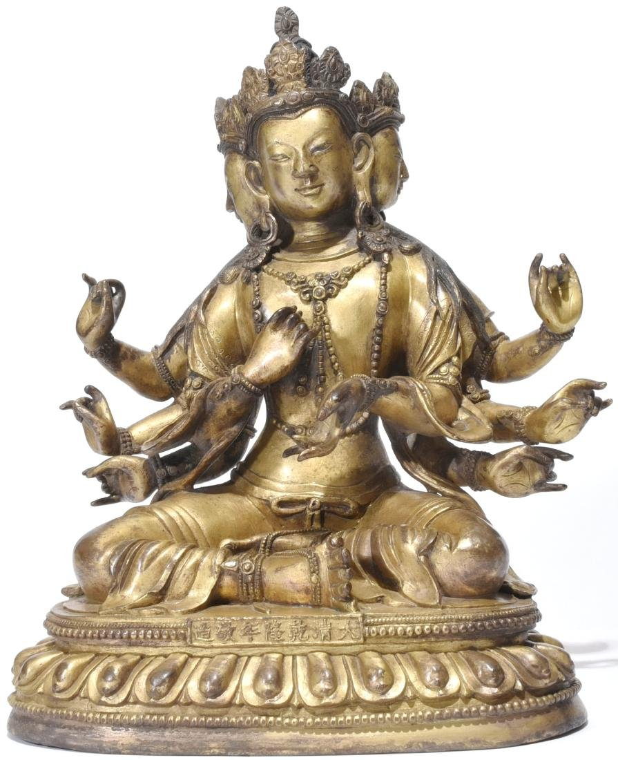 A Gilt-Bronze Multi-Armed Figure of Guanyin