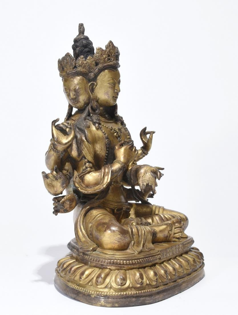 A Gilt-Bronze Multi-Armed Figure of Guanyin - 2