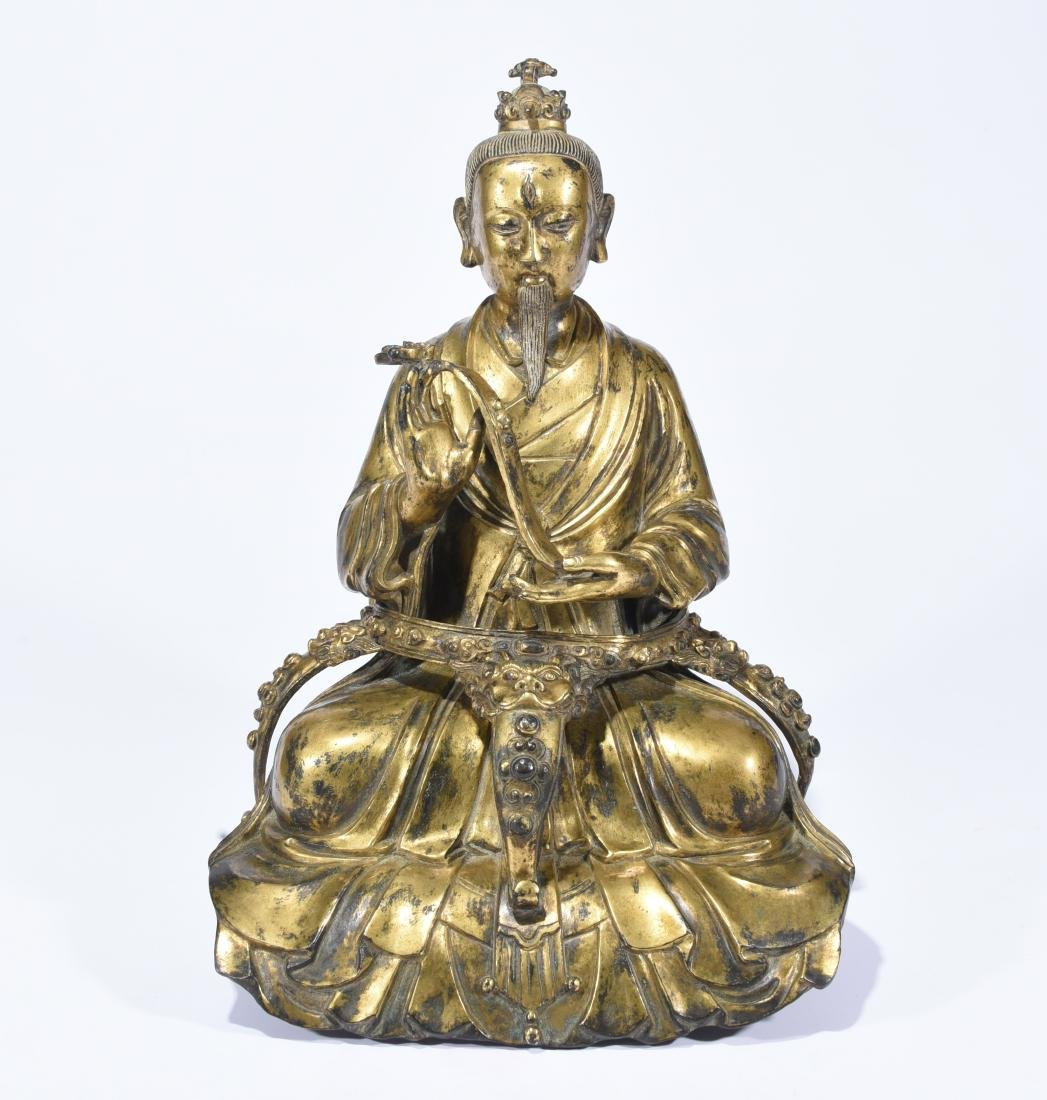 A Gilt-Bronze Figure of Taoist Priest