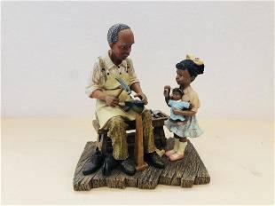 Shoemaker And Girl Sculpture