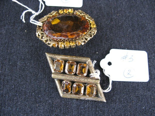 3: AMBER BROOCHES