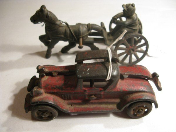 3: ANTIQUE CAST IRON RED PAINTED AUTOMOBILE AND CAST IR