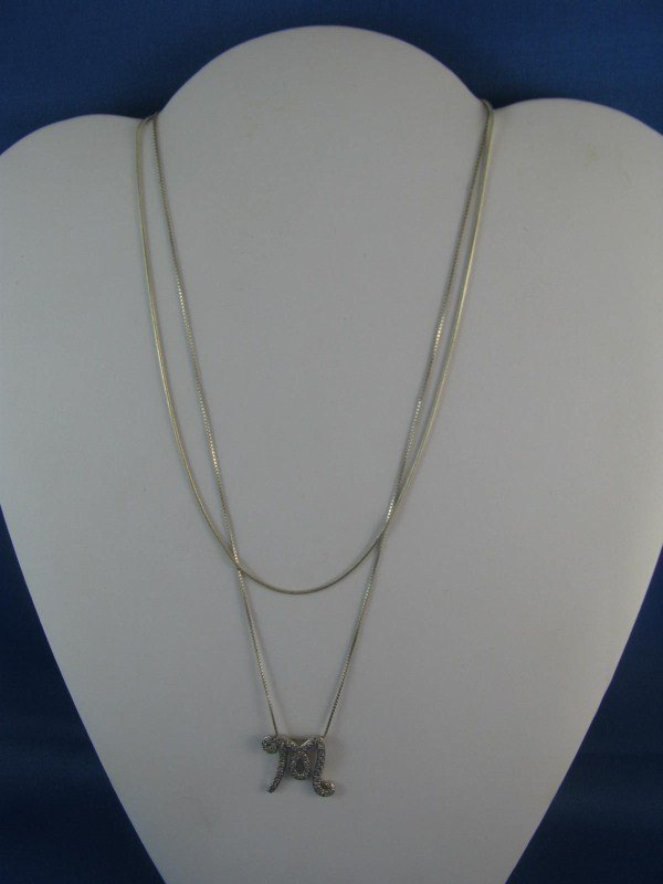 8A: TWO STERLING SILVER CHAINS - ONE WITH PENDANT
