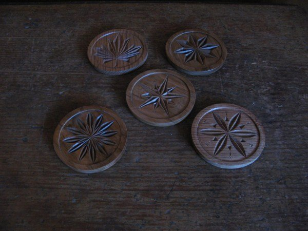 FIVE CARVED BUTTERNUT COASTERS